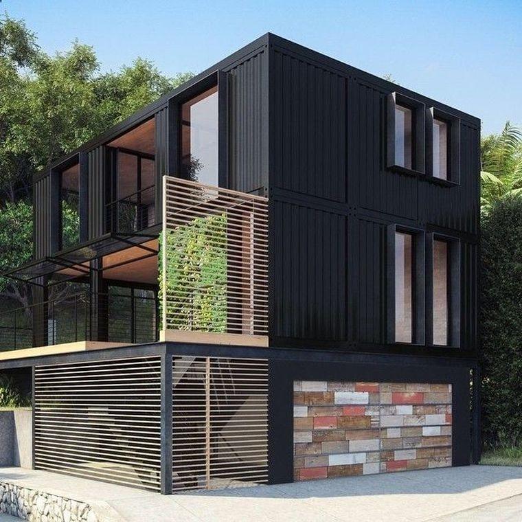 На фото стильный черный дом из контейнеров: